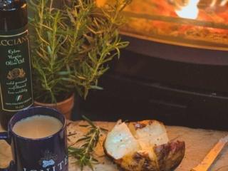 log burning stove baked potato