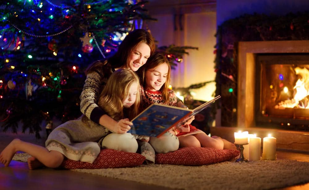 Family Reading In front of Fireplace